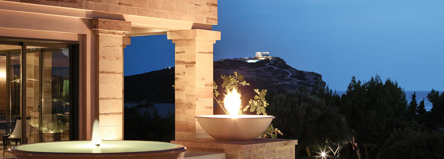 Stunning fire fountains and temple of poseidon view at Cape Sounio