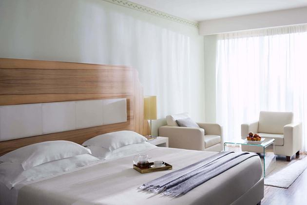 deluxe junior suite bedroom at Lefay Resort and Spa Italy
