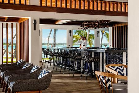 la terrasse bar with bartender at le saint geran hotel mauritius