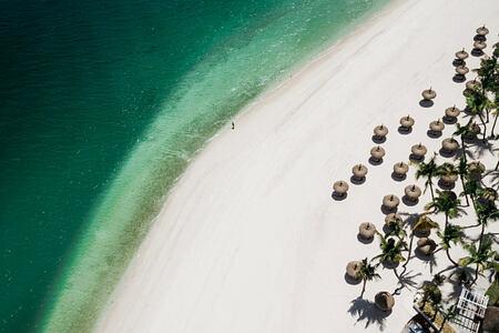 beach aerial view at le saint geran hotel mauritius
