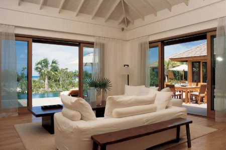 rocky point living room at como parrot cay resort caribbean