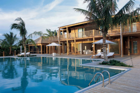 the residence exterior at como parrot cay resort caribbean