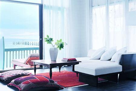 dhoni loft suite living room at Cocoa Island by COMO Resort Maldives