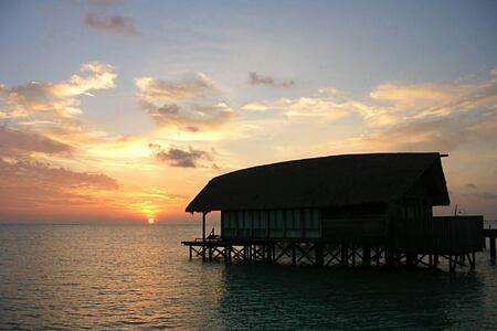 one bedroom villa as sunset at Cocoa Island by COMO Resort Maldives
