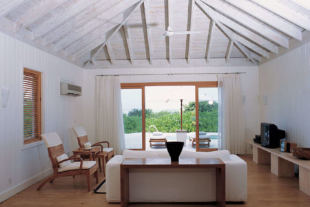 one bedroom villa living room at como parrot cay resort caribbean