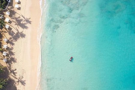 aerial beach view of boat at fairmont royal pavilion hotel barbados