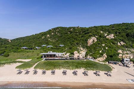 Aerial View to the Beach Club restaurant and private beach at amanoi luxury resort vietnam