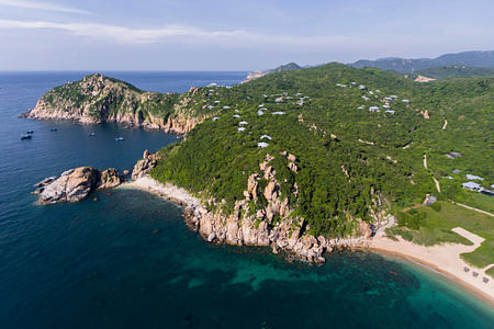 Aerial view of the property in the national park and look over the ocean and the bay at amanoi luxury resort vietnam