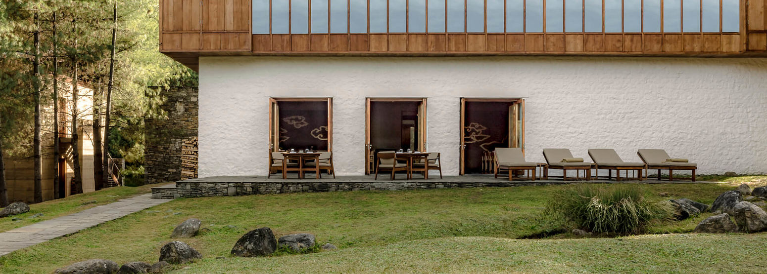 exterior viewed from firepit at amankora paro hotel bhutan