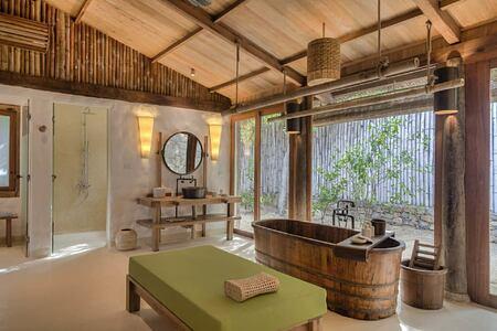 beach villa bathroom at six senses ninh van bay