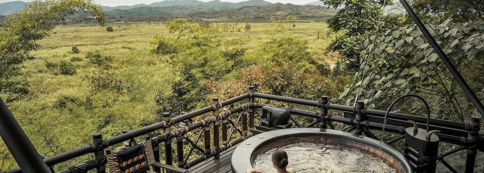 jacuzzi view at four seasons tented camp resort chiang rai