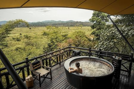 jacuzzi view at four seasons tented camp resort chiang rai