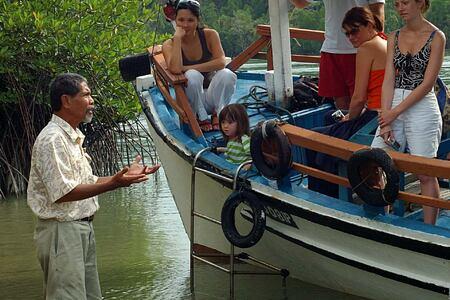 Captain Mokh with boat at Tanjong Jara Resort Malaysia