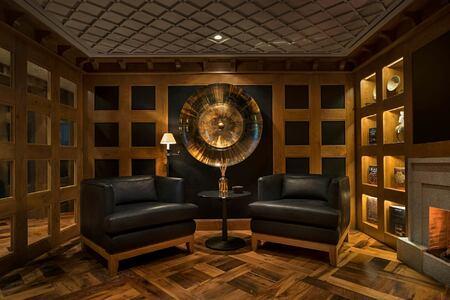 cigar lounge at aman le melezin hotel france