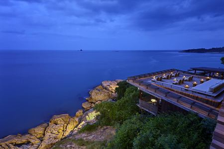 dining on the rocks at six senses samui hotel thailand