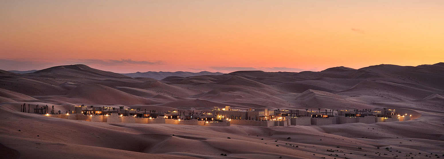 Beautiful twilight across the sand dunes at Anantara Qasr al Sarab