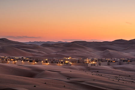 Beautiful twilight across the sand dunes at Anantara Qasr al Sarab