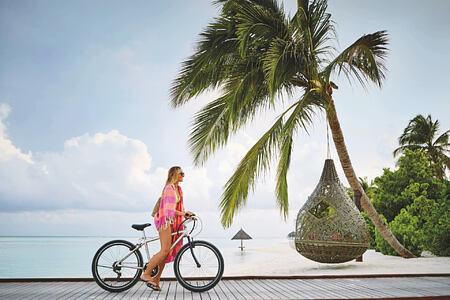 boardwalk biking at lux maldives resort