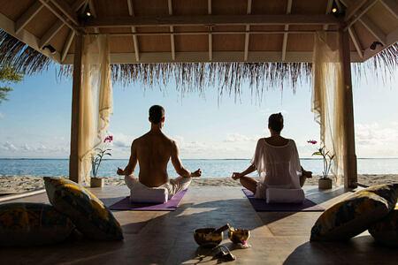 sunrise yoga at Kanuhura hotel Maldives