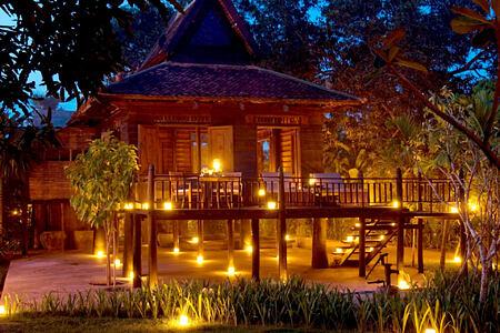 Khmer Village House Exterior Night at amansara hotel cambodia