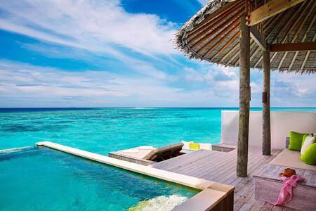 water villa with pool deck at six senses laamu hotel maldives