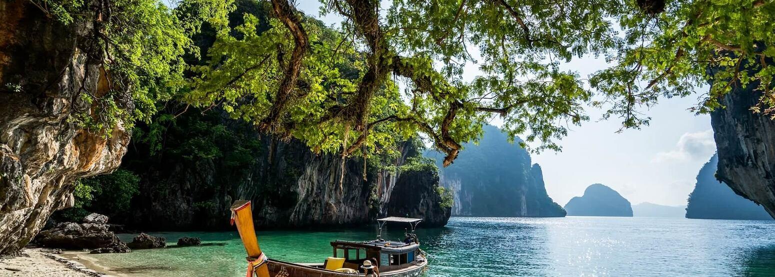 longtail boat island hopping at six senses yao noi resort phuket thailand