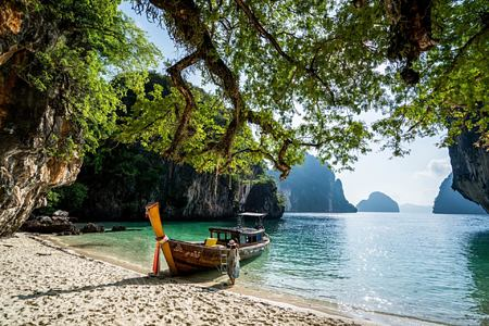 longtail boat island hopping at six senses yao noi resort phuket thailand
