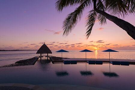 sunset at four seasons kuda huraa resort maldives