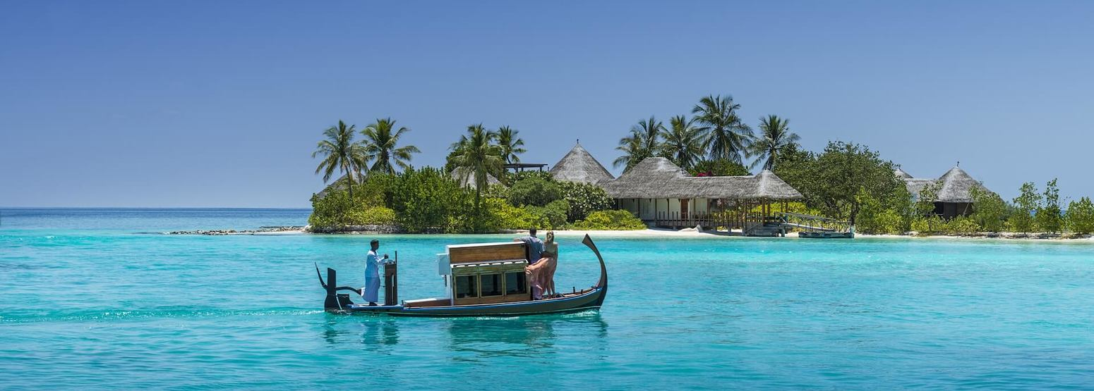 boat at four seasons kuda huraa resort maldives