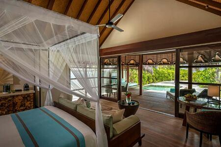 bedroom at four seasons kuda huraa resort maldives