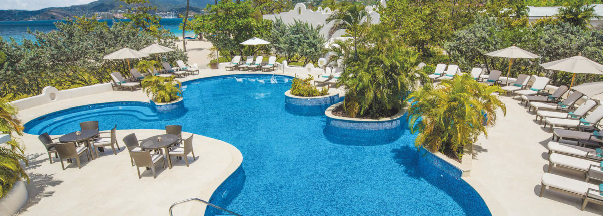 oasis swimming pool swim up jacuzzi at spice island beach resort caribbean