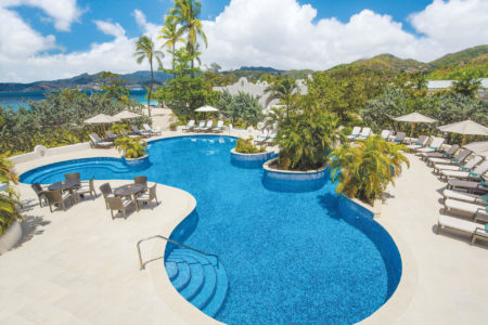 oasis swimming pool swim up jacuzzi at spice island beach resort caribbean