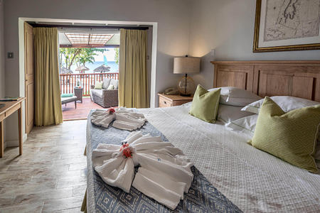 Ocean-view-room-looking-out-to-beach-at-ocean-winds-st-lucia