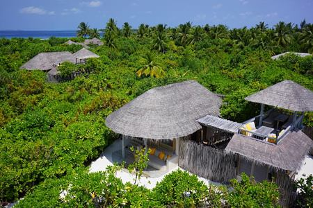 ocean beach villas aerial at six senses laamu hotel maldives