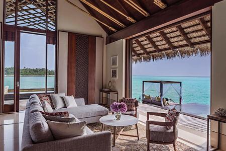 grand water villa living room at reethi rah resort maldives