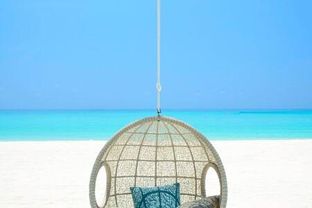 beach club hanging chair at reethi rah resort maldives