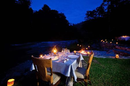 Outdoor evening dining Pacuare Lodge Costa Rica