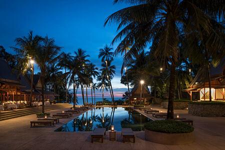 pool at night at amanpuri hotel phuket