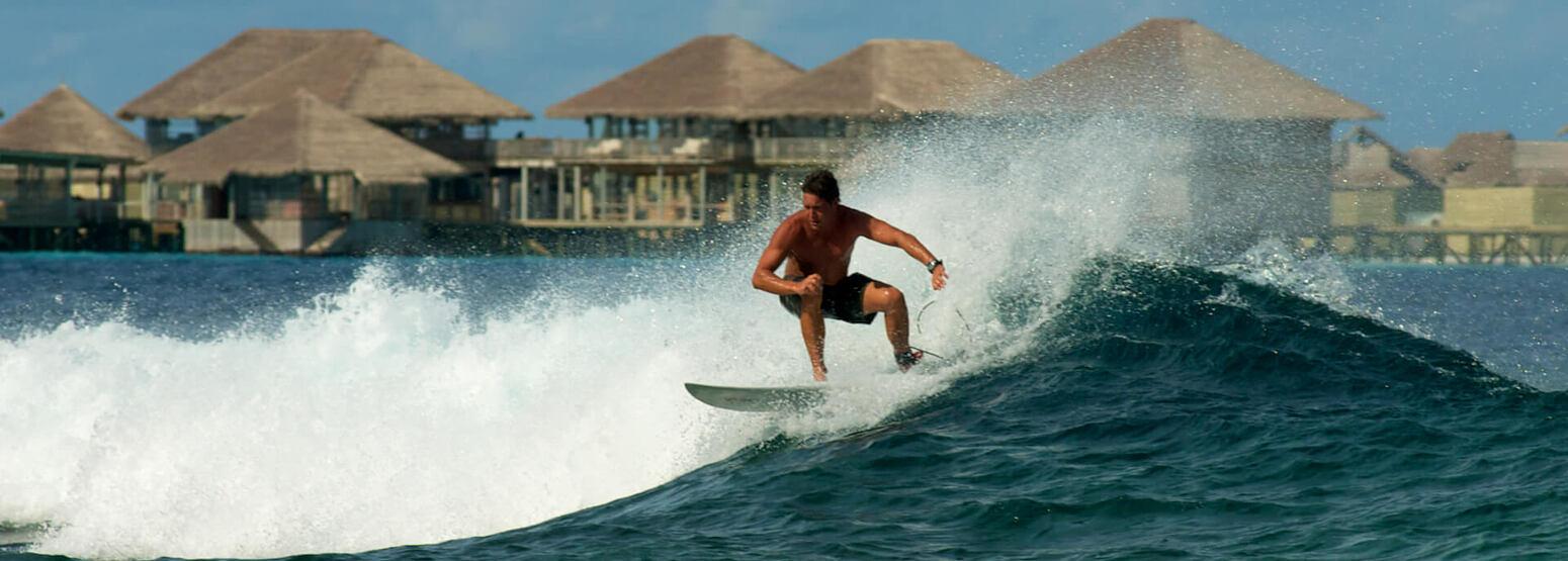 surfing at six senses laamu hotel maldives