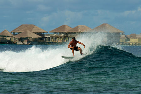 surfing at six senses laamu hotel maldives