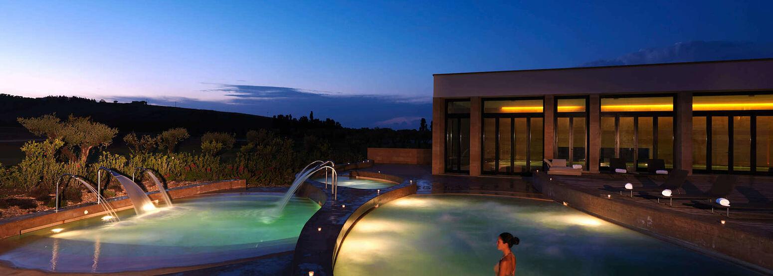 Thalassotherapy pools at night at Verdura Resort Italy