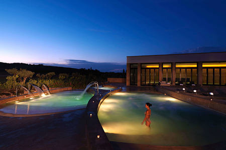 Thalassotherapy pools at night at Verdura Resort Italy