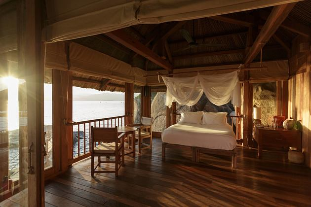 the rock retreat bedroom at six senses ninh van bay