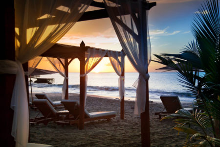 beach pergola sunset at ti kaye resort and spa jamaica