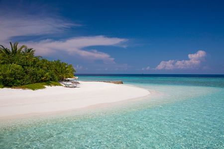 beach at coco palm bodu hithi resort maldives