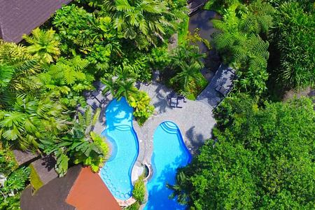 aerial view of swimming pools at lost iguana hotel costa rica