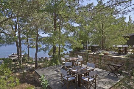 beach club dining terraces at amanruya hotel turkey