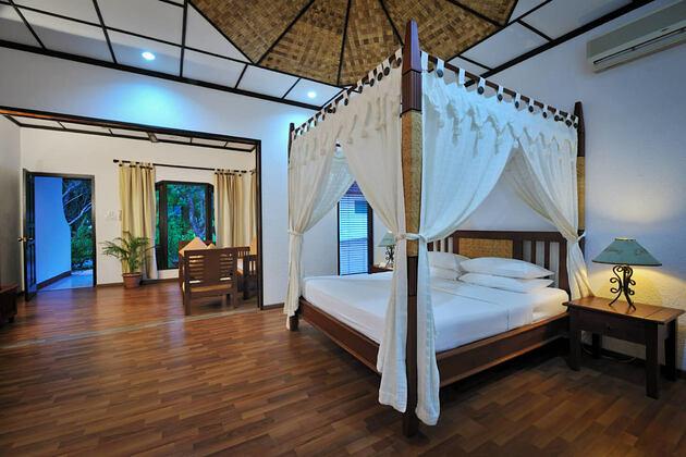 deluxe room interior at Bandos Island Resort Maldives