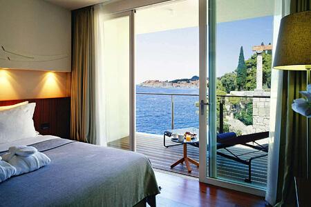 deluxe suite bedroom at sunrise at villa dubrovnik croatia