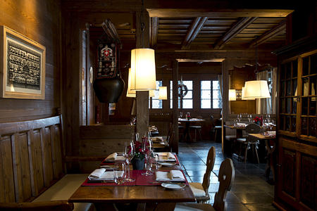 dining in the bar at alpina gstaad hotel switzerland